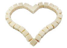 Heart from slices of the white refined sugar Royalty Free Stock Photography