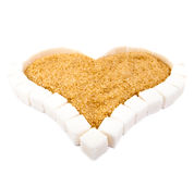 Heart from slices of white refined sugar and brown sugar Stock Images