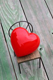 Heart on small chair Royalty Free Stock Photography