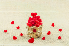 Heart in small wooden weave basket putting on the sack fabric. Royalty Free Stock Photo