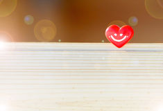 Heart with the smile and sun glare. Love story. Red heart. Abstract background Stock Image