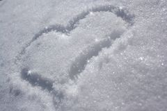 Heart on the snow. Drawing shape of the heart on the snow Stock Photo