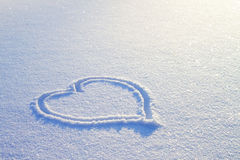 Heart on snow Stock Photography