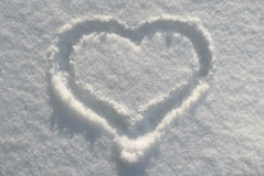 Heart on snow. A heart outlined on white snow surfase Stock Photos