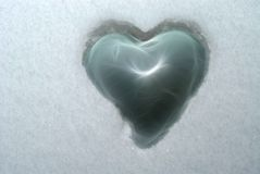 Heart in snow Stock Photo