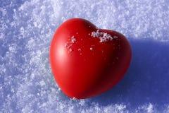 Heart on snow Stock Photography