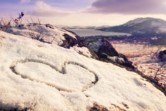 Heart on the snow. On the mountain Royalty Free Stock Photos