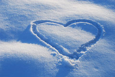 Heart on snow. Fresh deep snow, contrastive light with heart sign Stock Image