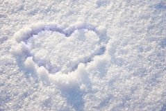 Heart on snow. As the background Royalty Free Stock Photo