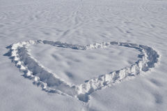 Heart in snow. On a cold winter day Royalty Free Stock Images