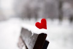 Heart on the snow-covered bench Stock Photography