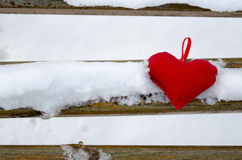 Heart on a snow covered bench Royalty Free Stock Photo