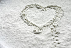 Heart in snow flour Royalty Free Stock Photography