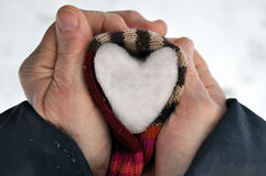 Heart of snow in hands Royalty Free Stock Photo