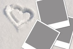 Heart in the snow and photos Royalty Free Stock Images