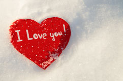 Heart in the snow in the rays of the sunset Royalty Free Stock Photography