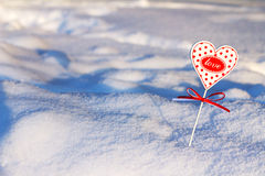 Heart in snow. The small heart is covered with snow Stock Photos