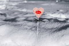 Heart in snow. The small heart is covered with snow royalty free stock image