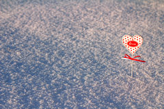 Heart in snow. The small heart is covered with snow stock photography