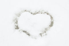 Heart on snow. Small heart drawn in the snow. The symbol of Valentines Day Stock Images
