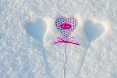 Heart in snow. The small pink heart is covered with snow royalty free stock photos