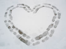 Heart on the snow. Of the tracks in the snow trampled down heart Stock Image