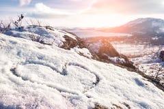 Heart on the snow Stock Photo