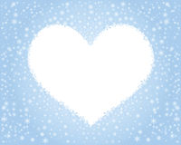 Heart of snowflakes. On a blue background Stock Photos