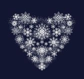 Heart from snowflakes Stock Photos