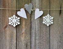 Heart and snowflakes handmade on the old wooden background. Concept. Christmas. Love. Rustic style. Card. stock images