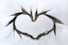 Heart on snowy window Royalty Free Stock Photography