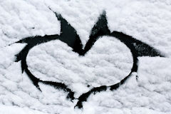 Heart on snowy window Royalty Free Stock Images