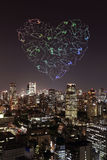 Heart sparkle Fireworks celebrating over Tokyo cityscape at nigh Stock Photo