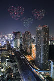 Heart sparkle Fireworks celebrating over Tokyo cityscape at nigh Royalty Free Stock Images