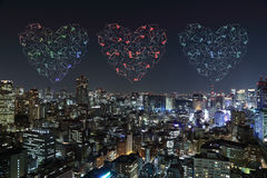 Heart sparkle Fireworks celebrating over Tokyo cityscape at nigh Royalty Free Stock Photos