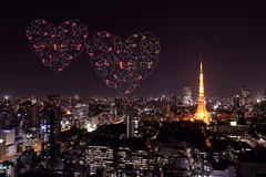 Heart sparkle Fireworks celebrating over Tokyo cityscape at nigh Stock Images
