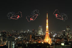 Heart sparkle Fireworks celebrating over Tokyo cityscape at nigh Stock Photography