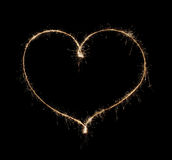 Heart from sparkler. Isolated on black background Stock Images
