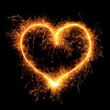 Heart from sparkler on black. Background. Design element for wedding or Saint Valentine card. Love symbol Valentine`s Day from bengal fire - using camera with Stock Photography