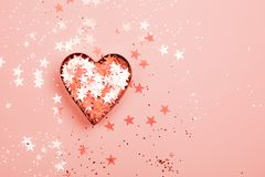 Heart with sparkles on Living Coral background. stock images