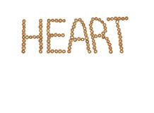Heart spelled out in cheerios. The word heart spelled out in cheerios on a white background Stock Photos