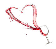 Heart splash from a glass of red wine Royalty Free Stock Photography