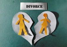 Heart split apart. Paper couple and heart split apart - divorce concept royalty free stock image