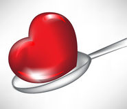Heart in spoon Stock Photos