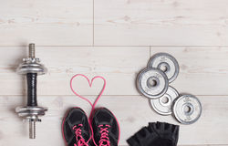 Heart and sport equipment Royalty Free Stock Image