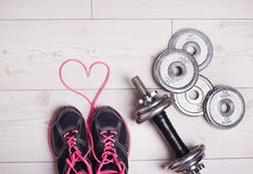 Heart and sport equipment Stock Photos