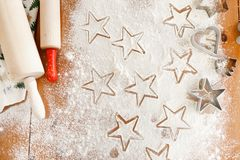 Heart and star shaped cookie cutters made by professional unknown cook, rolling pins for making thin dough. Home made. Christmas cookies ready to be baked Royalty Free Stock Images
