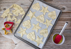 Heart and star shaped tortilla chips in cookie sheet. Horizontal image of of the process of making tortilla chips into star and heart shapes lying in a cookie Stock Images