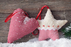 Heart and star in snow Royalty Free Stock Photo