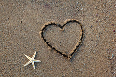 Heart and Starfish on Beach Royalty Free Stock Image